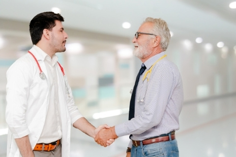 two doctors shaking hands